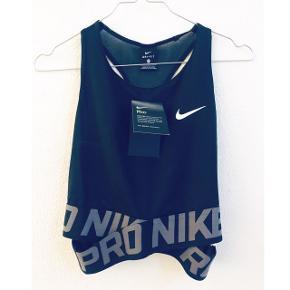 Nike Tank CrossoverAldrig brugt :-) Prisen er fast 🌸