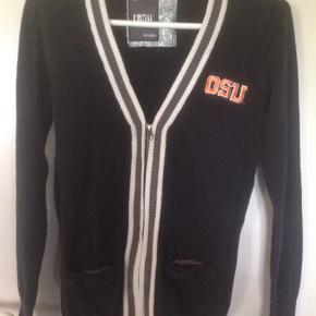 Comfortable soft Oregon State University sweater with a zipper. It has 2 small pockets on the front. Its super cute with the retro look. It's blue with white and grey as you can see in the photo.