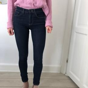 Classic jeans, dark color, very comfy.