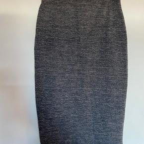 Blue/Grey brindle asymmetric pencil skirt from H&M Elastic waist Size S   Due to Covid-19 social distancing restrictions, trying on clothes I have for sale will not be possible. Pick up and purchase only please.