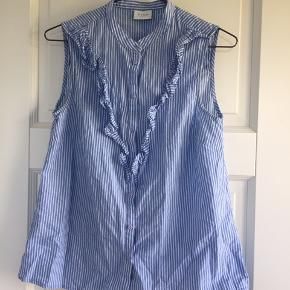 Stribet blå og hvid skjorte uden ærmer