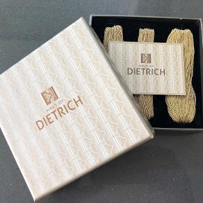 Super fin guldbelagt (18 karat) halskæde og armbånd fra Haus of Dietrich. Halskæden måler 49 cm. og armbåndet 22 cm. Begge dele kommer i original æske og er aldrig brugt. Fremstillet i Italien. Nypris 1.500 DKK