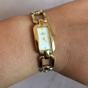 Inex ur, rem 20 cm. Led kan aftages ved guldsmed. Uret skal have nyt batteri.  Let slid i form af mindre ridser.
