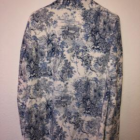 White blazer with blue jungle-ish pattern from H&M.