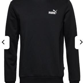 Puma sweatshirt. Med det lille mærke markeret på det ene bryst
