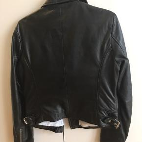 Leather jacket, used it couple of times but it's not exactly my style..it looks completely new