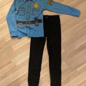 Nattøj med politi. Str 134/140. Bluse fra H&m. Sorte natbukser fra Molo. Brugt sammen.  Sender gerne med dao a 39kr