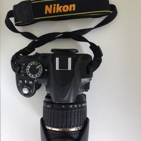 Nikon d3100 spejlreflekskamera sælges. Kameraet er brugt men fejler absolut intet.   Der medfølger:  Originale 18-55mm objektiv Tamron 18-210mm objektiv  Kamerataske med rem og regnslag. Tasken har 2 yderlommer og 2 små inderlommer  2 x kameraoplader   Batteri   Sælges samlet for 1500 kr