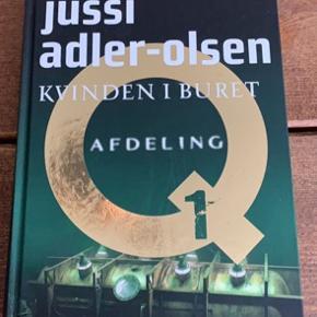 Jussi Adler-Olsens bog kvinden i buret. Hardcase og helt som ny. Er ikke engang læst