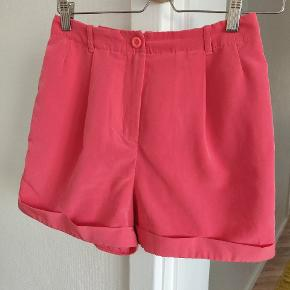 High waisted pink shorts from American Apparel. Size S but on the smaller side. There is a very small wear at the back, as shown in last image. But the shorts look like new otherwise. 100% polyester