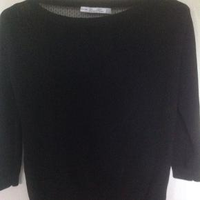 Black 3/4 sleeve top by Zara. The back is exposed as you can see in the photos.