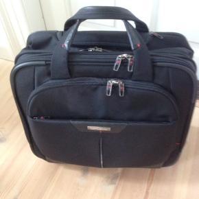 Samsonite rejsetaske/Trolle i fin stand med få brugsspor.