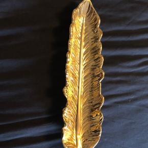 Sælger dette søde slags guld fad det fejler ingen ting byd gerne