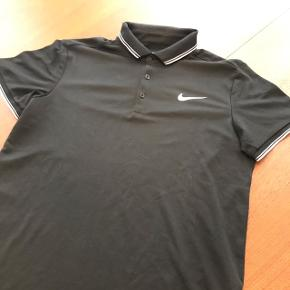 Navy Nike Dry Fit polo.
