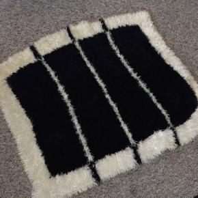 Dejligthjem strikkede tæppe langhåret