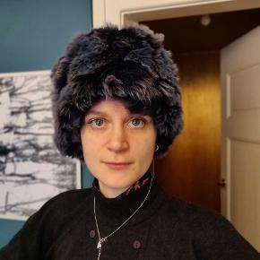 Beautiful synthetic fur hat. Very warm.