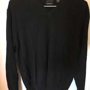 Sweater fra Greg Norman.