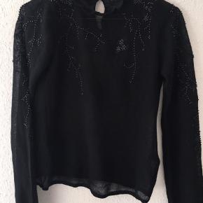 Lettere gennemsigtig langærmet top eller trøje/bluse
