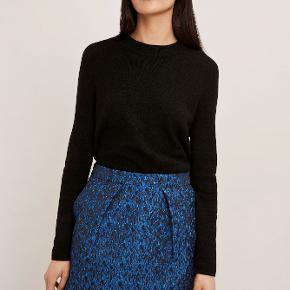 Så smuk nederdel, som er god til de kommende festlige begivenheder.