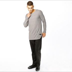 Light gray loose sweater. New price 1500dkk
