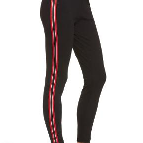 Black stretch pants with red, white and black stripes on the side. It's in really good condition. It's by the Nordstrom brand. It's high waisted and fits like a glove.