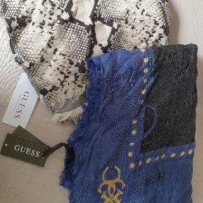 2 stk guess tørklæder aldrig brugt. Sælges kun samlet og bytter ikke.