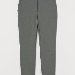 Bukser svare til en str. 48. Grå/grønne Aldrig brugt og sælges stadig i forretningen. Har klippet mærket af.