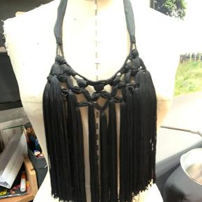 Tassel, fringe necklace with ribbon closure so it's adjustable up and down!