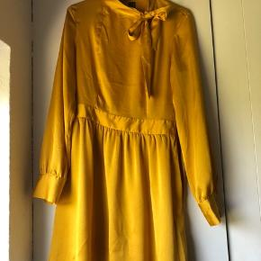 Fin kjole, brugt en enkelt gang