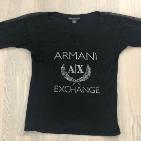 Super fin AX bluse købt i New York. Har klippet mærket i siden ud - men jeg er ret sikker på, at det er 100% bomuld