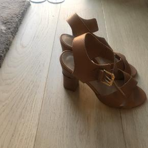 Never used sandals - selling them as they are too small for me