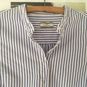 Newlon skjorte i str 40. 100% bomuld. Perfekt stand. Pris 300,- pp Bytter ikke.