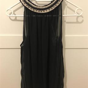 Varetype: Bluse top Farve: Sort  Ny bluse, top. Pris 300+porto Bytter ikke