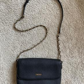 Almost new. It can be worn as crossbody, shoulder or clutch.  Real leather.