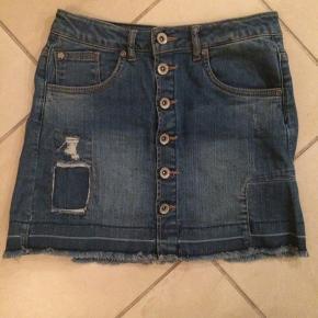 Kort cowboy nederdel.