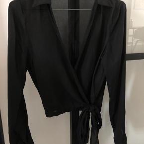Black sheer shirt (PRETTYLITTLETHING brand). Size XXS/XS. No defects.