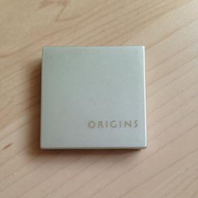 Øjenskygge fra Origins i farven 57 Glistening Granite.  Brugt få gange, som det kan ses på billederne.   Sælges også i én anden farve.