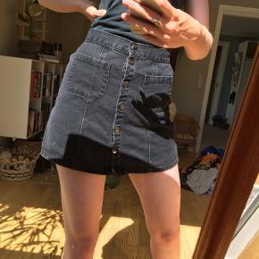 A-Line nederdel med trykknapper og lommer