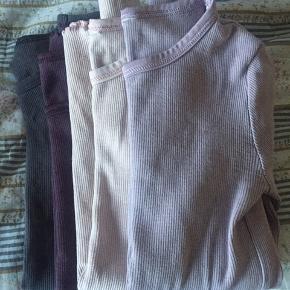 4 stk langærmet bluser. Mærkerne inden i blusen er klippet af.