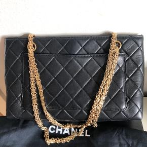 This is vintage ! Comes with the authentic cards. Box , protective bag and Chanel paper bag! You won't find this anywhere anymore ! Can wear both with short trap and long strap and over body ! So many ways as well.     Strap is 23 cm used short and 46 used long. The length is 29 cm X 19 cm x 7 cm