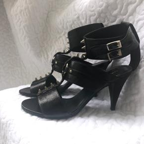 Heel 8,5 cm. Worn a couple of times. With a box and dust bag. Resoled before ever been used. Metal studs, closure on the ankle.