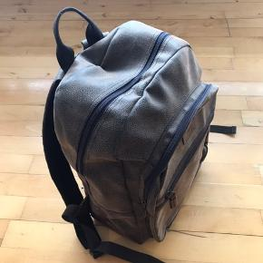 Great leather Camel Active backpack with no flaws. Zip work perfect too