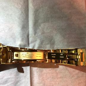 R.olex Submariner gold with blue dial Helt nyt, aldrig brugt. Indgraveret krone i glas Safir glas God vægt
