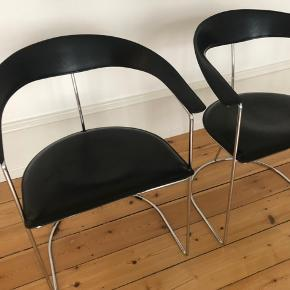Design classic   Two elegant Arrben Canasta designer chairs in black saddle leather on chrome. Early 1960s, Made in Italy, very good condition.  Authentic pieces with label (see picture).  In very good conditions  Can be delivered within Copenhagen  Price per chair