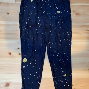 Beautiful Stine Goya pants with gold print. Some wear on the back of the pants - please see photos