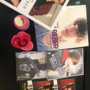 2 bøger, 2 parfumer, 2 dvd'er og 2 cd'er. I god stand