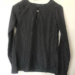 Bluse in schwarz mit weissen punkten grösse 34 XS