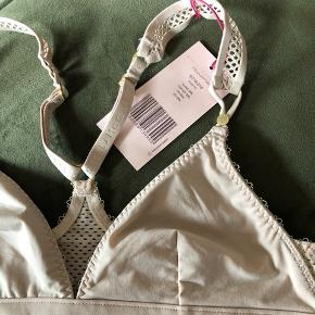 Brand new Stella triangle bra with racer back in size small. Fast price.