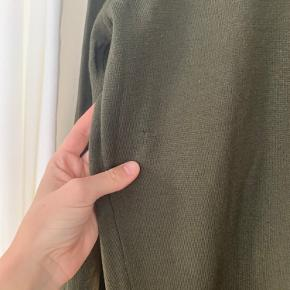 a hole not visible during wear, washed once otherwise not worn very delicate material