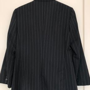 Massimo Dutti blazer - dark blue with 100% wool external material. Comfortable and elegant :)